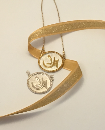 """Two sterling pendants of the Ancient Hebrew letters showing Chen or """"Grace"""" designed by Marla Jean Clinesmith"""